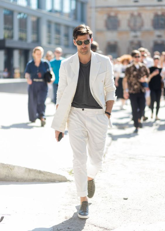 a creamy suit, a graphite grey tee and matching sneakers with no socks for a formal summer look