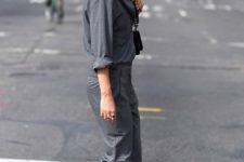 a graphite grey boiler suit, white sneakers and a black bag for a casual outfit