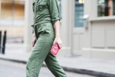 a green boiler suit, pink trainers, a tiny pink graphic clutch for a bright summer look