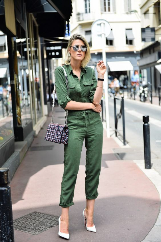 a green boiler suit with cropped pants, white heels and a printed bag for a touch of chic