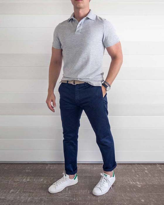 a grey polo shirt, navy pants, white sneakers will make up a cool work outfit with a sporty feel