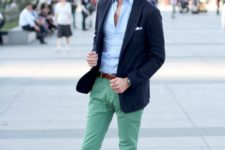 a light blue button down, bright green pants, a navy blazer and brown shoes with no socks