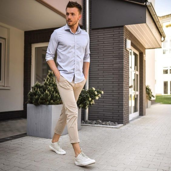 a light blue button down, tan cropped pants, grey sneakers for a comfortable summer outfit