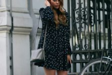a moody floral dress with long sleeves, a dark bag and black slipper mules for a dark outfit