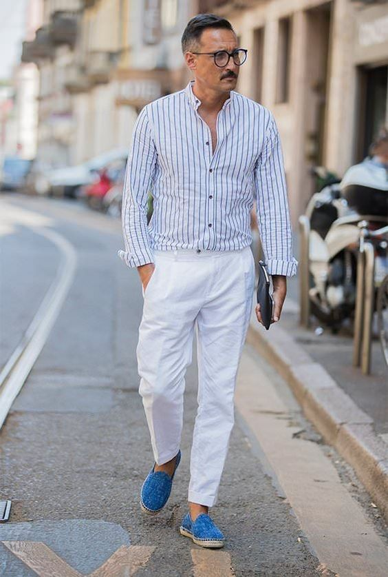a summer men's look with blue espadrilles, a striped button down, white pants, will fit an office