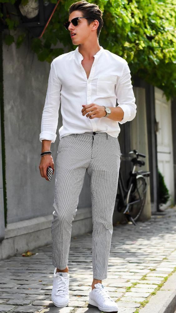 a white button down, grey pants, white sneakers for a chic yet casual work outfit