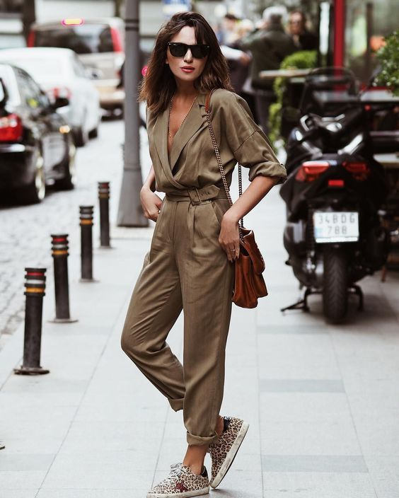 an elegant camel boiler suit, a brown bag and animal print slipons for a comfy look