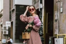 a relaxed summer look with a straw bag
