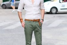 an off-white shirt, olvie green pants, brown loafers and a matching belt for a chic and comfy look