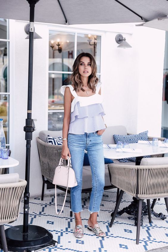 blue decomposed jeans, a white and stripes wide strap top with ruffles, printed slipper mules and a creamy bag