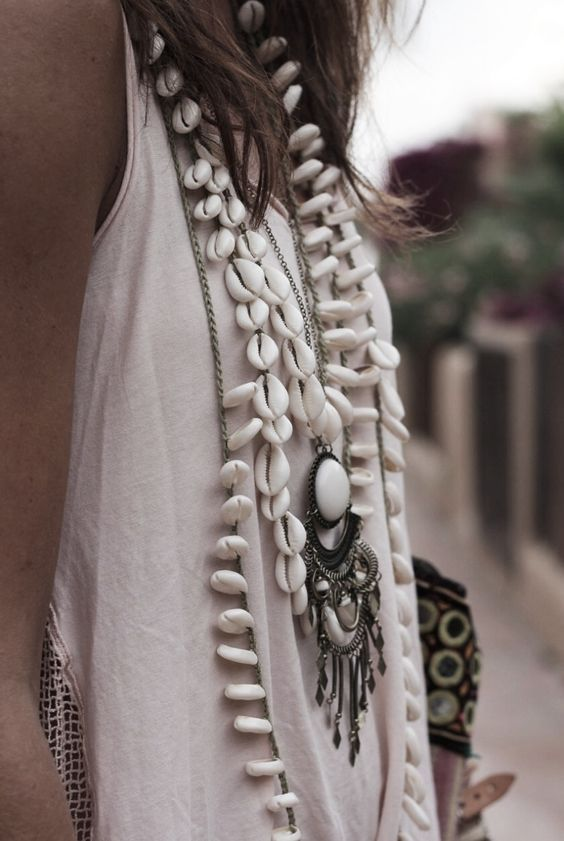 feel free to wear layered seashell necklaces and a vintage pendant to create a boho touch
