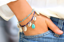 layered seashell bracelets in various colors will spruce up your look giving it a beahcy touch