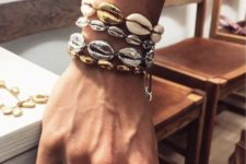 layered seashell bracelets with shells in various metallic shades are amazing for a boho touch