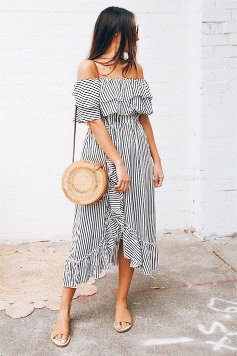 a feminine outfit with a black and white off the shoulder striped midi dress, a round straw bag and tan slippers