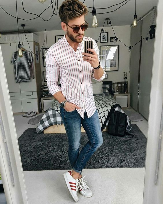 a stylish casual summer look with blue jeans, a striped red and white shirt, red and white Adidas sneakers