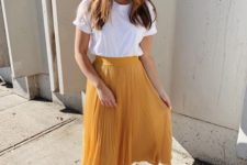02 a white basic tee, a marigold pleated midi skirt, white sneakers compose a simple summer look