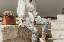 02 a white blouse with buttons and tied sleeves, plaid cropped pants, white canas sneakers and a camel bag