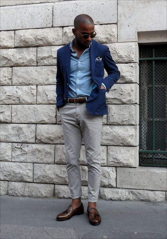 a casual work outfit with a blue shirt, a navy blazer, grey pants, brown loafers and a matching belt