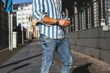 03 a relaxed summer outfit with a striped blue and white shirt, blue jeans, white sneakers