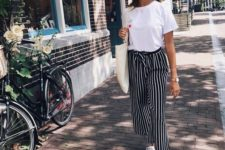 03 a white basic tee, striped high waisted pants, white canvas sneakers and a large tote
