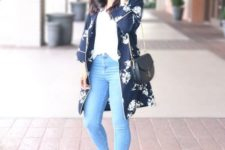 03 blue skinnies, a white top, a navy floral kimono, navy mules and a black saddle bag