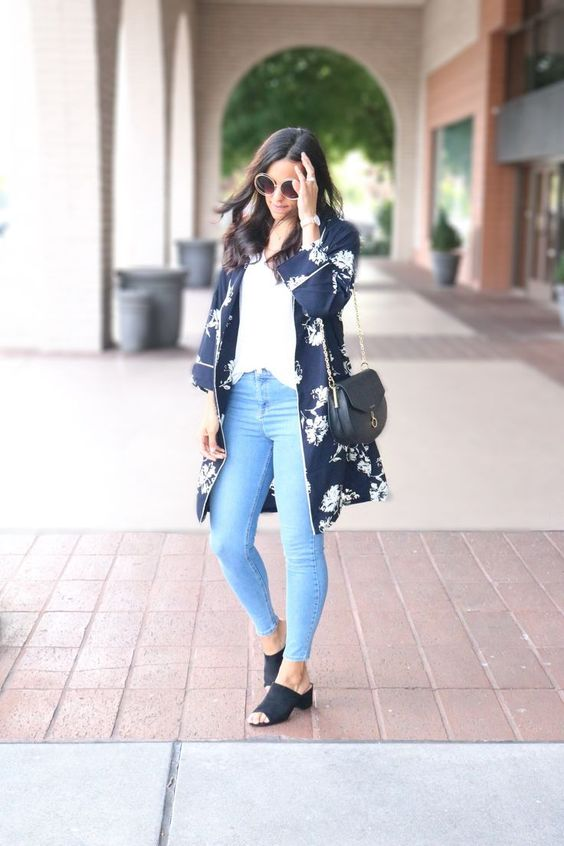 blue skinnies, a white top, a navy floral kimono, navy mules and a black saddle bag