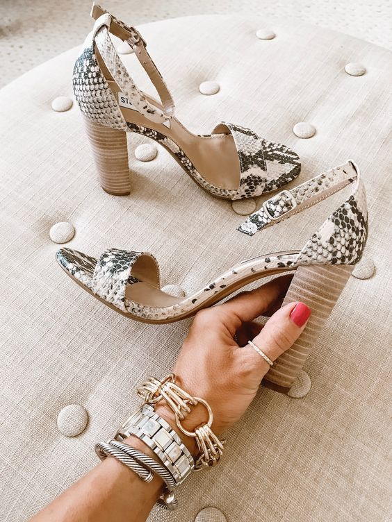 snake skin shoes with high heels of a different material for an accent
