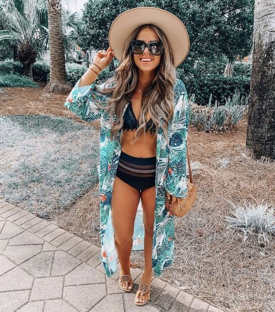 a bright tropical leaf print kimono helps you embrace the location and adds color to the outfit