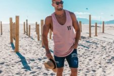04 a pink top, blue denim shorts, a hat and sunglasses for a relaxed and bright beach look