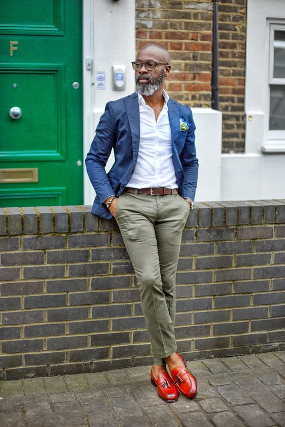 a super bold look with a white button up, grey pants, a navy blazer and red loafers plus glasses