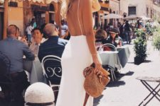 04 a white minimalist midi dress with a side slit and a fully open back on straps for a modern feel