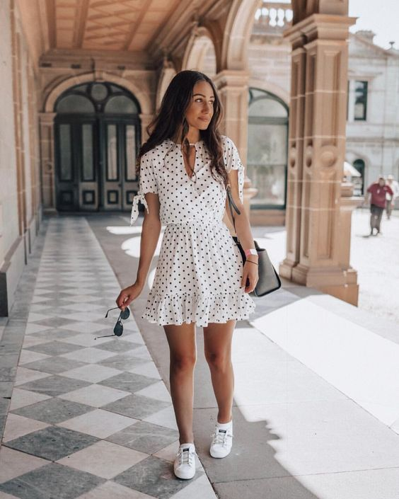 a white polka dot short sleeve dress, white canvas sneakers and a grey bag for a girlish look