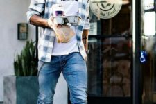 05 a printed tee, a checked shirt, blue jeans and grey sneakers for a casual and comfy look