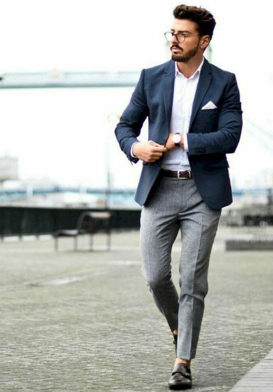 an elegant look with a white button up, a navy blazer, grey pants and brown shoes with no socks