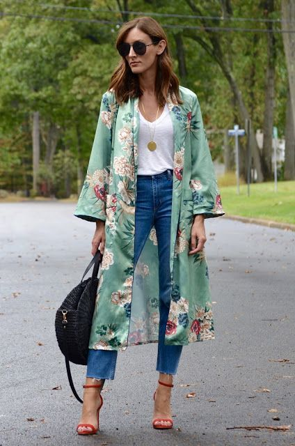 blue jeans, a white top, a green silk kimono, red heels and a black straw bag