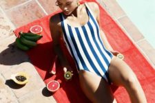 06 a minimalist blue and white striped one piece swimsuit is a stylish option that always works