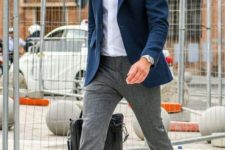 06 a white button up, a navy blazer, grey pants, black loafers and a matching bag