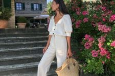 07 a holiday look with linen pants, a linen shirt on buttons, black slipper sandals and a straw bag
