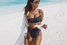 07 a modern navy bikini with a one shoulder top and a high cut leg bottom plus a white coverup