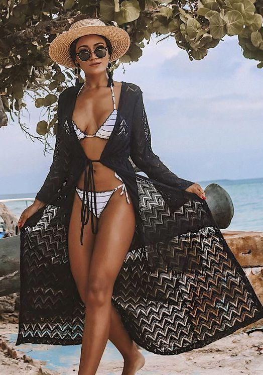 a monochromatic look with a striped black and white bikini, a black crochet coverup, a straw hat