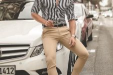07 a striped black and white shirt, tan chinos, white sneakers make up a look suitable for work