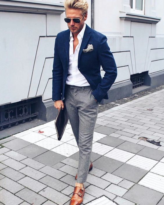 an elegant summer work look with a white shirt, a navy blazer, grey pants, brown shoes and sunglasses