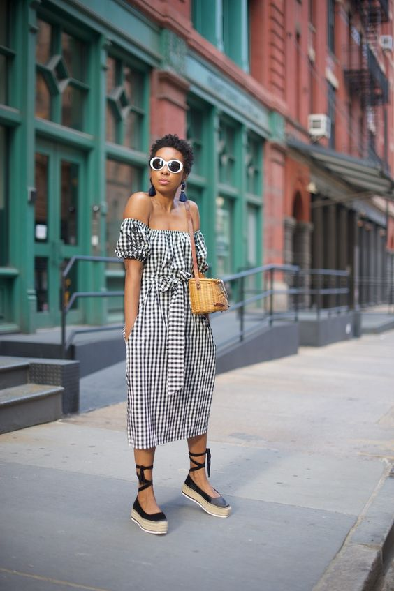 an off the shoulder gingham midi dress with a sash, a wicker bag and black espadrilles