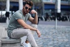 07 an olive green tee, grey ripped jeans and white sneakers for a casual and relaxed outfit