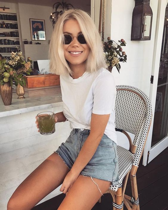 bleached blue denim shorts, a white tee make up a timeless and relaxed summer look