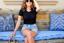 08 a black t-shirt, denim shorts, tan embellished slippers and a round straw bag