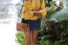 08 a bold look with an off the shoulder mustard top with long sleeves, a navy mini, neutral sandals and a brown bag