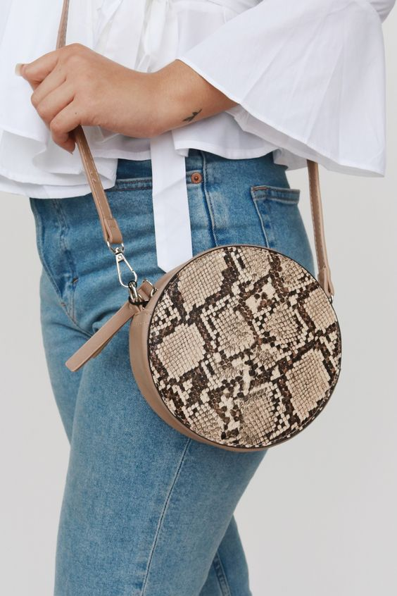 a round snake print bag will add a bold and whimsy touch to your everyday outfit