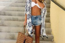 09 a blue and white printed kimono with tassels will finish off your boho beach look