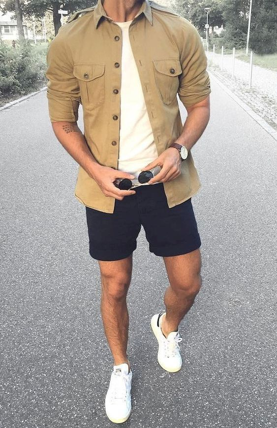 a white tee paired with a tan shirt, navy shorts and white sneakers for a cooler day